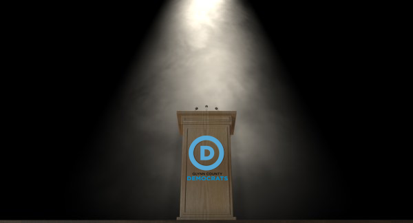 Spotlit podium with Glynn County Demorats logo
